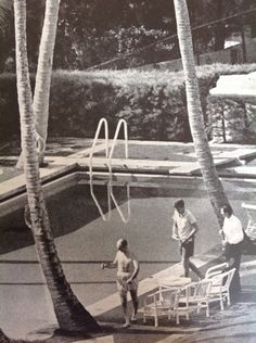 The vacationing President-elect with two aides prepare for a swim at Joe Kennedy's Palm Beach Home.