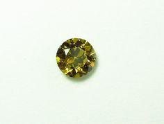 0.81 ct, Green, Round Brilliant, Brownish Greenish Yellow