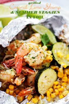 Grilled Coconut Lime Shrimp and Summer Veggies in Foil - Corn, zucchini and coconut-lime marinated shrimp grilled in foil-packets makes for one easy, delicious, 30-minute summer dinner!