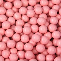 Light Pink Sixlets - Bulk Decorator Candy Coated Chocolate Balls  Delicious small chocolate candy covered balls  Sixlets are the candy coated chocolate flavored candies back from when we were kids, & now they are available in a great light pink decorator color. Each candy ball has a finely polished shiny finish making it an attractive decorating candy. This Light Pink chocolate candy is a great accent color by itself or add in perfect if celebrating a baby shower