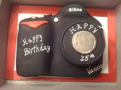 Nikon Camera Cake: This Nikon camera cake is dominican pound cake with strawberry filling and vanilla black fondant.