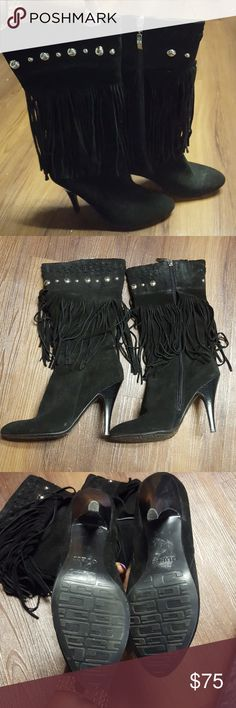 Black Guess Boots Excellent  condition scuffs, scars or gashes in this beauty....barely worn. Just needs a little lint removed. (Will do when purchased) make an offer. Or bundle. Guess by Marciano Shoes Heeled Boots