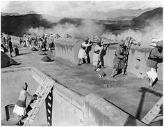 PEOPLE OF INDIA: Images of British India -Practice firing from the walls of a fort on the Northwest Frontier; photograph courtesy of the Centre of South Asian Studies, University of Cambridge; 20th century. The Frontier was the loosely controlled area between British India and Afghanistan inhabited by various tribal groups. The British and Indian armies frequently operated in the region to maintain order and provide valuable military experience for the troops