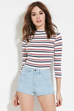 A pair of denim shorts with a high-rise fit, a cuffed hem, a four-pocket construction, and a zip fly.