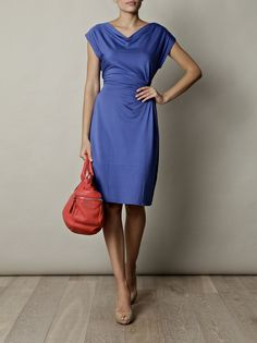 Update your off-duty wardrobe staples with this blue Bibo silk jersey dress from Weekend by MaxMara. Team its rich blue hue with colour-pop accessories and soaring heels for a sleek, polished finish. Styled here with MaxMara pumps and Sportmax shoulder bag.
