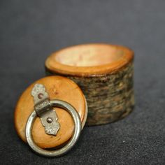 This charming little box was carved in a piece of wood so its unique !! It is just gorgeous :-).  It could hold your small treasures or hide some tiny secrets...  This listing is for one (1) box. Meas. approx. 45mm at its largest diameter x approx. 27mm thick. ***Please note there may be some slight imperfections due to its vintage nature and being part of the charm of this item.