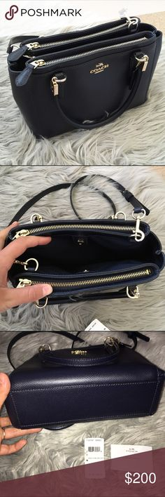 FINAL REDUCECoach Mini Christie Crossbody I carried this for about a week on vacation and it turned out to just be way too small for my needs! It's a beautiful bag with no flaws. Practically brand new. I purchased from another Posher and it did not come with a dust bag. The color is Midnight, a very dark navy that is almost black! Price firm Coach Bags Crossbody Bags