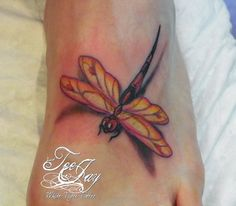 Dragonfly foot tattoo