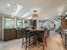 "Modern Kitchen with Signature design by ashley willow 24"" bar stool ii (set of 2), U-shaped, Kitchen island, Slate Tile"