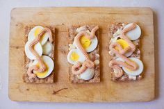 Kalles Kaviar (Swedish caviar spread) on crispbread and hard boiled eggs.