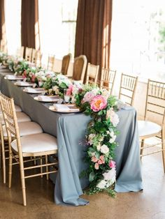Long head table with lush floral garland table runner by Kate Foley Designs on light blue linen with gold chiavari chairs and two statement chairs for bride and groom for summer wedding at Hickory Street Annex - Photos by Elisabeth Carol Photography Wedding Table Garland, Summer Wedding Centerpieces, Wedding Arrangements, Wedding Decorations, Centrepieces, Table Centerpieces, Pink Table, Wedding Reception, Wedding Dress