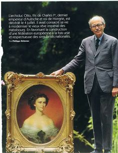 Othon de Habsbourg (Otto von Habsburg) in the garden of his house, Villa Austria, Poecking, Germany, standing with a portrait of his great-grand aunt, Empress Elisabeth of Austria-Hungary. The portrait hung in the drawing room of Villa Austria. From an article in Paris Match, early 1990s.