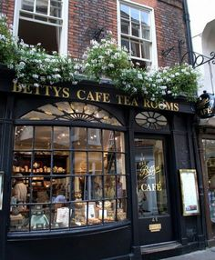 Betty's Tea Room - The Effective Pictures We Offer You About facade shop A quality picture can tell you many things. You can find the most beautiful pictures that can be presented t Coffee Shop Design, Cozy Coffee Shop, Paris Coffee Shop, French Coffee Shop, Coffee London, Vintage Coffee Shops, Tea Design, Vintage Shops, French Cafe