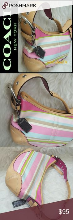 Coach Canvas Leather Purse Coach Signature Bag Collection in Vibrant Pastel Shades of Pink, Tan and Blue! Features Canvas with Leather Trimming and Silver Tone Hardware! Chic Buckle Details on Both Sides of  Handle! Tonal Stitching Details Throughout!  Handcrafted from the Finest Materials Trimmed with Genuine Leather! Top Zipper Closure Opens to Fully Lined Interior with Zipped Pocket! Good Sized for Everyday Use! Single Handle with about 7 Inches Drop! Excellent Used Condition! Coach Bags