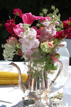 Love this mix of flowers in the silver pitcher.