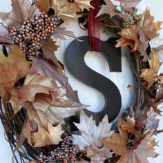 Front door wreath with letter