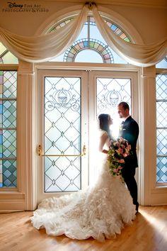 Sunlight bursting through the Wedding Pavilion doors helped create this stunning photo #Disney #wedding #WeddingPavilion #photography