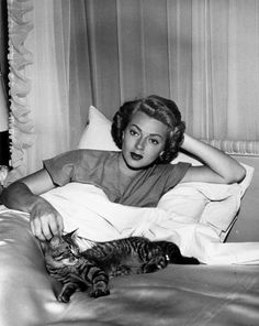 Lana Turner and her cat. Is this early or late in her career, coz that is not the blonde waves she's famous for!