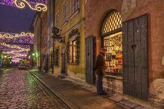 Man outside bookstore in Warsaw.