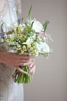 Natural hand tied bouquet. I like the wild looking shape of this bouquet. Would want it bigger and with more roses for me. Perhaps lavender to add in some dark purple. Like the daisies.