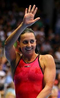 Rebecca Soni waves after winning the 200-meter breaststroke.