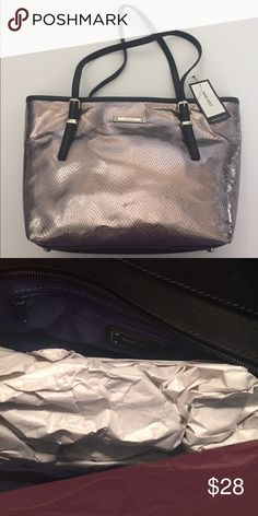 Nine West Metallic Bag Beautiful Silver Metallic Nine West Bag! Top zip with one interior zip pocket and two open pockets! Great for all seasons! Hot Metallic! Nine West Bags Satchels