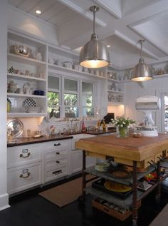 Love the clean white, butcher block island and subtle touches of colors in this kitchen.  South Shore Decorating Blog: What I Love Today