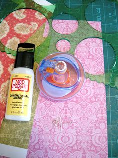 This is from Etcetorize: DIY Paper Jewelery, but I think it would be a great way to make custom bling/charms for cards & scrapbooks using scrapbook paper. EASY & AFFORDABLE