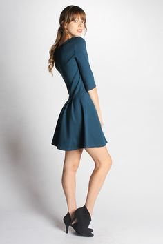THE DETAILS Take a feminine flared skirt and pair it with an edgy front zipper and you have the Brittany dress. With 3/4 sleeves and a slight drop waist, it is made from thick stretch organic cotton m