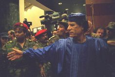Leader of Libya Muammar Gaddafi and President of South Africa Nelson Mandela attend the Organization of African Unity summit in Sirt / March 1, 2001