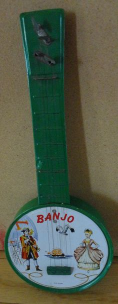 Vintage green tin litho toy banjo.