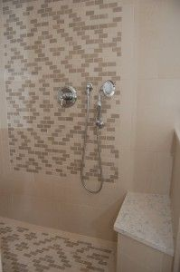 Bathroom shower with bench in the corner and tile mosaic design - created by Normandy Designer Ann Stockard Mosaic Designs, Normandy, Mosaic Tiles, Building Design, Master Bath, Ann, Bench, Corner, Shower
