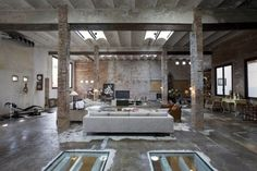 Barcelona Printing Press Renovated Into Industrial-Chic Modern Loft  The allure of the old infused with the new could not be more pronounced in this studio retrofit of an aging printing press in downtown Barcelona. Minim Interior Architects subtly slipped modern elements into the rough brick plaster and concrete core to create a surprisingly light-filled and airy living space. The interior features a minimalist modern palette and a taste for antique furniture