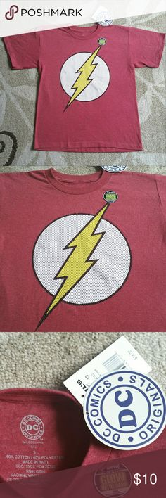 DC Comics The FLASH Tshirt NWT NWT DC Comics The FLASH T-shirt in color Red Heather! Brand new with tags still attached. This shirt features a lightly faded red color and a large centered logo for the Flash! The painted area is Glow in the Dark!!! Unisex, in a kids size Small. Cotton and Polyester. DC COMICS Shirts & Tops Tees - Short Sleeve