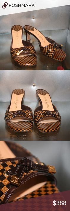 LOUIS VUITTON Damier Patent Leather Mule These chic and elegant Louis Vuitton open toe mules are a great addition to any wardrobe! These shoes feature Damier patent leather with bow and goldtone hardware details. Leather lined upper and sole for a comfortable fit and a touch of class. This is unique style any fashionista would not want to miss. EU SIZE 37 Louis Vuitton Shoes Mules & Clogs