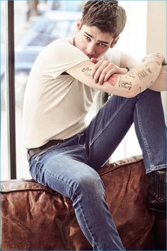 Cole Mohr relaxes in a classic t-shirt and distressed denim jeans for Koton Jeans' spring-summer 2016 campaign.