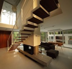 Contemporary Stairs, Fireplace, Modern Concrete House in Cariló, Argentina