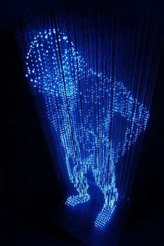 Man with No Shadows by Makoto Tojiki: Construction of a life-sized man made of LED lights which hang on threads from the ceiling.