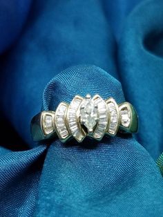 Check out this item in my Etsy shop https://www.etsy.com/listing/531533761/marquise-baguette-diamond-ring