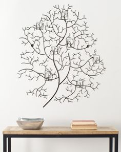 This graceful, tree-inspired, wall-mounted piece will add a relaxing organic vibe to any room. Carefully wrought from iron, it holds ten glass cups to acco