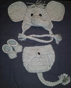 Crochet Newborn Baby Girl or Boy Safari Elephant Costume - Photo Prop - Beanie Hat, Elephant tail Diaper Cover, and Booties. Perfect homemade animal hat for your little one!  These adorable photo props will make the most memorable newborn baby pictures for years to come! The hat is made with soft yarn and shiny black buttons for the eyes. The diaper cover is easy to use with each side having a loop for the button. It has a long, gray elephant tail on the back that is extra thick to look more…