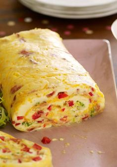 Bacon Omelet Roll with Salsa — Finely chopped red peppers and green onions give this bacon omelet roll its festive appearance. Add salsa, and it's definitely a party waiting to happen.