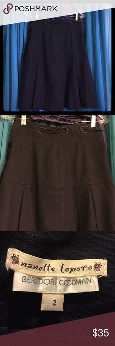 NANETTE LEPORE at BERGDORF GOODMAN Navy Skirt-Sz 2 Navy blue skirt with yoke waist and pleats. Ribbon is woven at waistline.  Retails at $298 Nanette Lepore Skirts