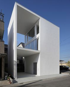 this dwelling designed by japanese architect takuro yamamoto offers residents a large outdoor patio, despite its small footprint.