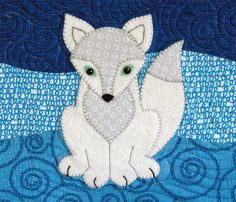 Swift, the Arctic Fox  The quilting design work is just beautifully done. The color choices are great. Love this.