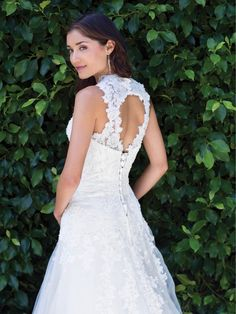 Kenneth Winston '1488' size 4 used wedding dress back view on bride