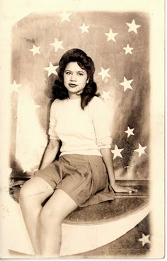 Over the moon.  Circa the 1940s.