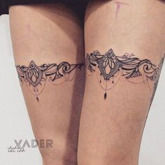 Matching ornamental leg bands. Tattoo artist: Tatiana Vader