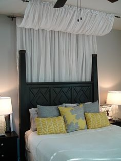 DIY Bed Canopy with 2 curtain rods and 2 sets of curtains.