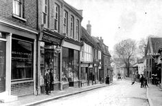 A view of Crown Street - The Co-operative Shop is on the left handside of the photograph with customers waiting in the doorway. Notice the road is unmade and the only transport is a bicycle and a horse and cart.